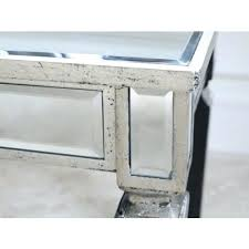 a sensational and eye catching console table with a contemporary style mirrored design the piece is sure to be a remarkable piece of modern furniture