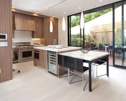 table island combo. mid-sized trendy l-shaped light wood floor eat-in kitchen photo in table island combo t