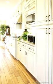 kitchen cabinets with light wood floors antique white dark hardwood