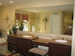 very large bathroom mirror with granite countertops