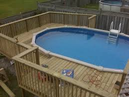Wooden Pool Decks Wooden Pool Deck Kits Fascinating And Simple Above Ground Pool