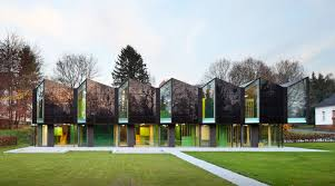 modern architectural design. Saw-tooth Roofed Nursery Blends In With The Landscape A Historic Campus Germany Modern Architectural Design 0