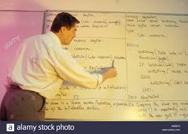 computer science tutor writing on whiteboard university of stock computer science tutor writing on whiteboard university of westminster london uk