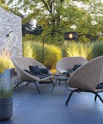 patio furniture for small patios. Creating An Outdoor Room With A Stone Wall, Slate Tile Terrace, Rattan Furniture \u0026 Lighting - Trees Ornamental Grasses As Garden Backdrop. Patio For Small Patios