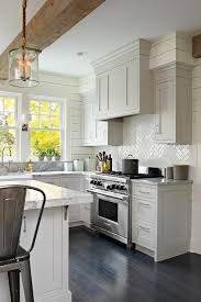 kitchen design lighting. light gray shaker kitchen cabinets with glossy white herringbone tile backsplash transitional exposed beam design lighting