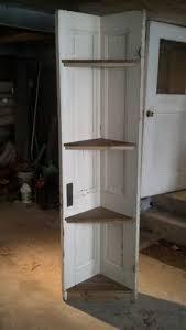 old door made into a corner shelf
