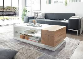 and oak coffee table with glass shelf