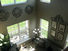 two story foyer wall decorating ideas tall walls on chandeliers for foyers that decor tips