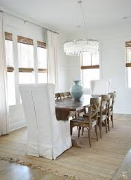 coastal dining room farmhouse x back chairs capiz chandelier beach decor dining room white slipcovered dining chairs natural woven shades 2