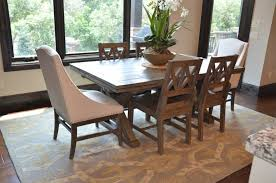 dining table with captains chairs at either end jun 16