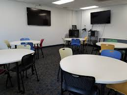 classroom 28 medium sized collaborative classroom with five movable round tables each seating four this room is located in the education wing of the main