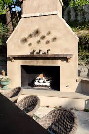 smooth stucco fireplace with lompoc cobblestone detail a reclaimed wood mantle and starbursts