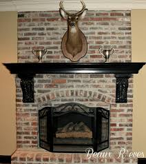delectable image of home interior decoration using wrap around fireplace mantel along with black wood shelf over fireplace and aged brick fireplace surround