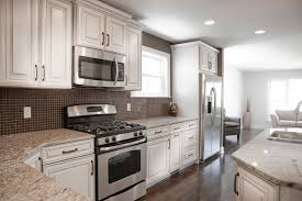 Captivating Contrasting Tones Of Dark Brown And White Throughout This Kitchen, With  Natural Hardwood Flooring And Amazing Design