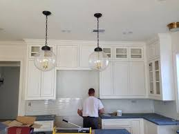 i do like that little visual comfort flush mount over where the sink will be a lot too regina andrew pendant large globe