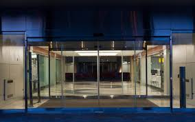 night time view of tormax tx9500 all glass sliding doors installed by explore1 ca