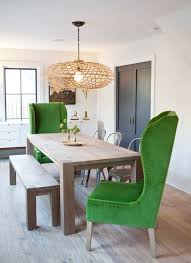 impressive emerald wingback armchairs in the dining room pretty much the dream right here