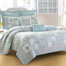 laura ashley comforters the quilt features petite fl prints on a block patchwork pattern in a