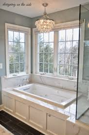 master bathroom chandeliers using boxed square tub also glass backsplash as well as gray wall