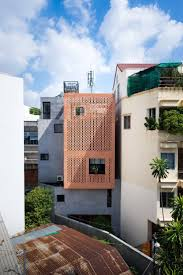 Tropical Space Designs a Warm Contemporary Home in Ho Chi Minh City, Vietnam