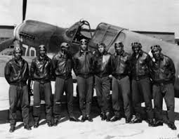 tuskegee airmen fiction nonfiction literacy eight tuskegee airmen in front of a p 40 fighter aircraft by signaleer is in the public