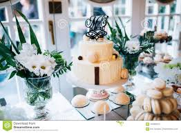 Candy Bar And Wedding Cake With Flowers Table With Sweets Buffet