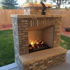 this modern designed outdoor fireplace includes straight lines and two stone finishes for added detail