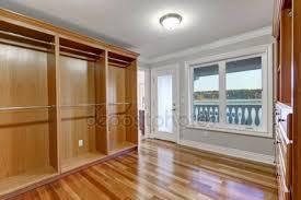 empty walk in closet. Empty Walk In Closet With Hardwood Floor And Door To Balcony \u2014 Stock Photo