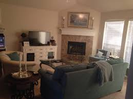 love this corner fireplace living room layout, especially with the  mismatched couch and loveseat.
