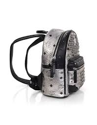 100 authentic mcm silver monogram crystal studded mini backpack features silver canvas with mcm