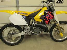 here s the 96 rm125 i red this winter and used that seat cover those are the stock shrouds i didn t replace the graphics