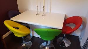 smartie white gloss extending dining table 4 multi coloured swivel chairs