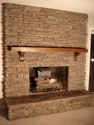classic wooden mantel for fireplace hearth ideas added concrete floors in rustic living room designs