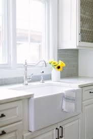 small farmhouse kitchen sink and vintage faucet transitional