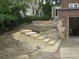 plete backyard renovation installing natural stone steps and nature stone patio