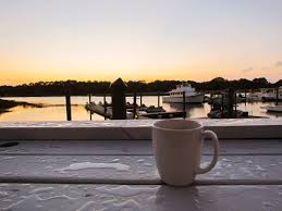 Cup of black coffee and beans over wood table and sunset. Summer Beach Sunrise Coffee Page 1 Line 17qq Com