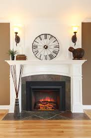 an electric fireplace insert convert your old wood burning fireplace into an easy to use
