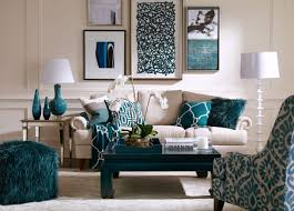 White couch allows art and Peacock blue and teal accents to pop