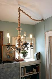 hang chandelier angled ceiling
