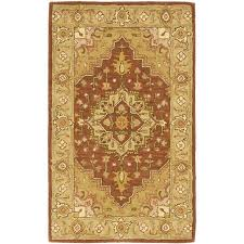 safavieh heritage 12 x 18 hand tufted wool pile rug in rust and gold