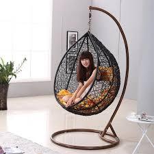 hanging birdcage chair zen like black rattan indoor hanging chair birdcage hanging chair by hands