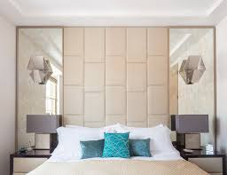 symmetrical mirrors with a leather headboard in between