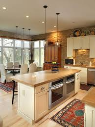 Eat-in kitchen - rustic eat-in kitchen idea in Columbus with stainless steel