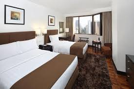 a bed or beds in a room at city garden hotel makati