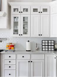 Traditional kitchen idea in New York with white backsplash, subway tile  backsplash and white cabinets