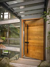 wooden front doorThe front door is often the focal point of a home exterior  a