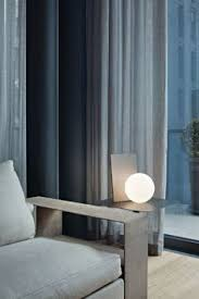cool lighting design. flos extra t table lamp brightens the corner of this modern living room interior with light cool lightinglighting designlighting lighting design f