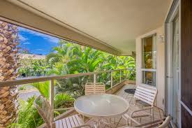 A lanai runs the length of the unit with doors from both bedrooms and the  living