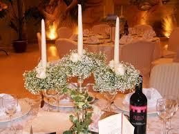 Centrotavola matrimonio con candele o fiori