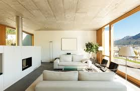 Modern Living Room Pairs White Walls And Natural Wood Framing With Concrete  Floor And Ceiling.